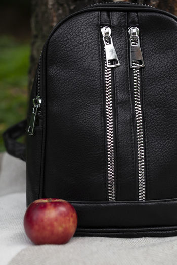 Close-up of black and apple