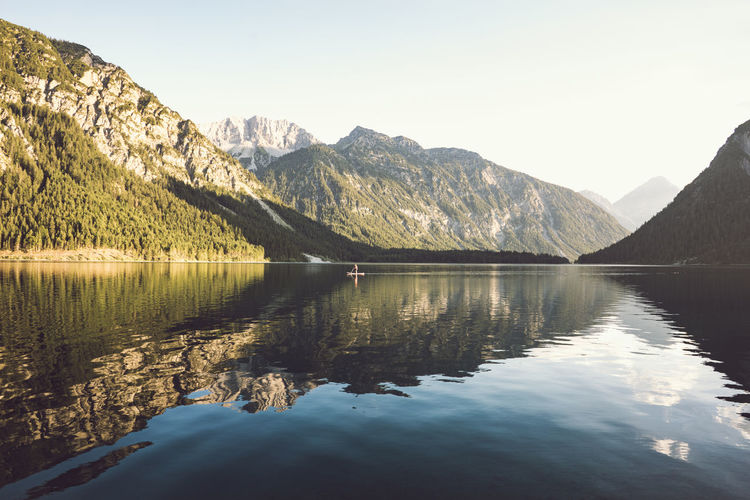 Mountain reflections in a lake. Mountain Scenics - Nature Water Beauty In Nature Tranquil Scene Tranquility Mountain Range Lake Sky Reflection Waterfront Nature Idyllic Non-urban Scene Day No People Tree Outdoors Clear Sky Mountain Peak