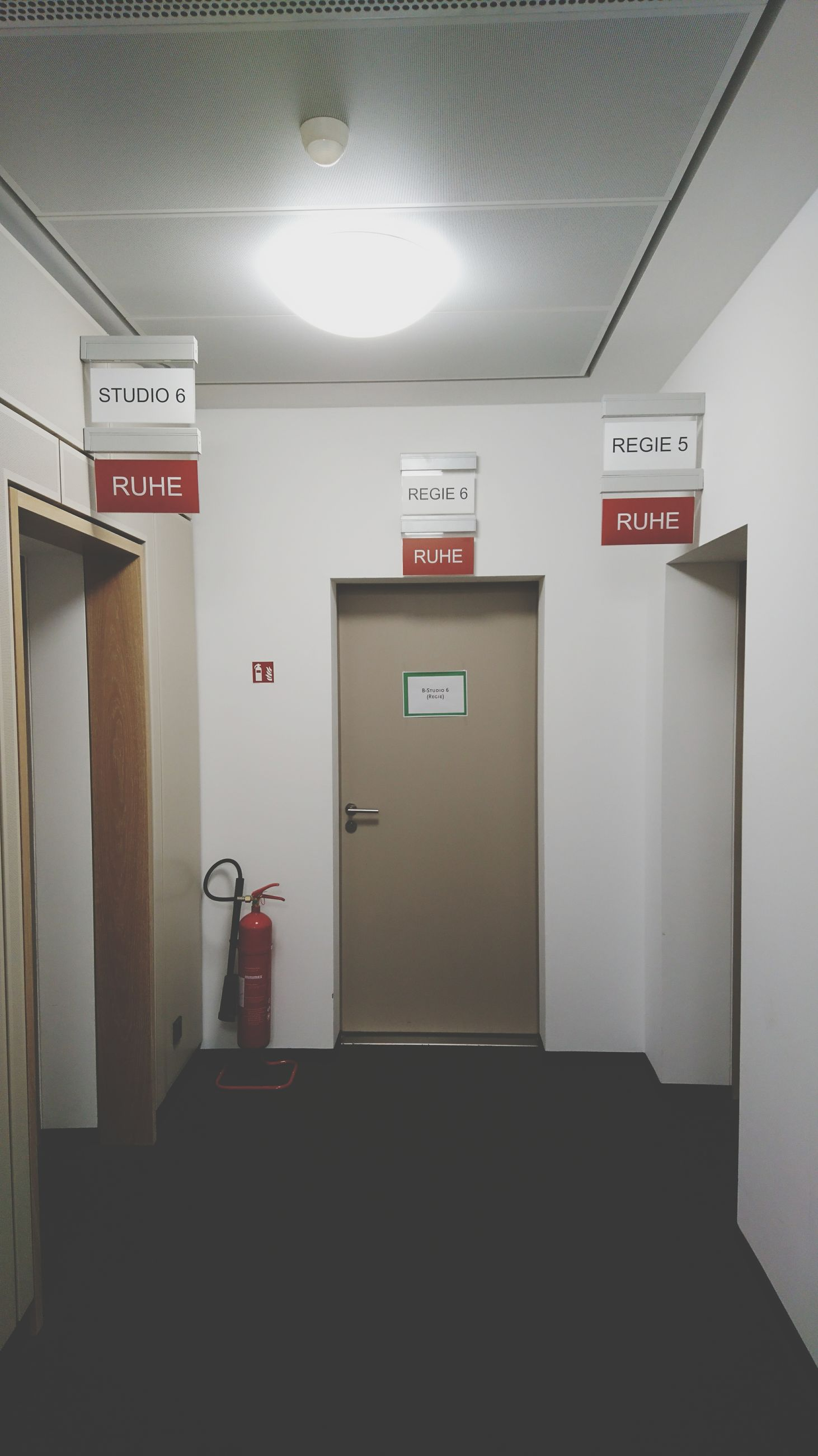 communication, exit sign, text, safety, indoors, emergency exit, information sign, emergency sign, no people, illuminated, emergency equipment, security system