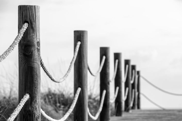 Krull&Krull Images Mallorca Black & White LINE Railing Steg The Week On EyeEm Beach Black And White Close-up Cord Day Focus On Foreground Lead No People Outdoors Sky Son Serra De Marina Walkway Wood - Material Krull&Krull Images Black And White Friday