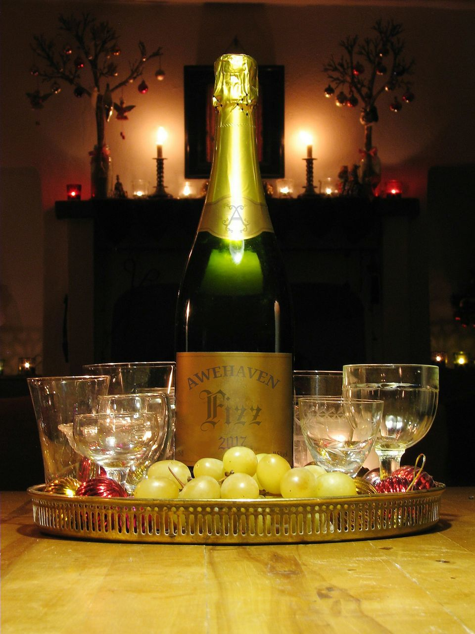 illuminated, food and drink, candle, table, indoors, wineglass, bottle, celebration, no people, freshness, plate, fruit, food, yellow, drinking glass, christmas decoration, night, sweet food, close-up, ready-to-eat