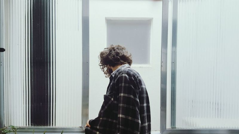 Window One Person Waist Up Looking Through Window Portrait Indoors  Curly Hair Day Pensative White Cloudy Day Adult People Home