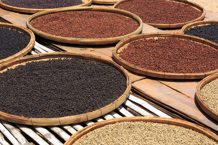 High angle view of spices in plates drying outdoors