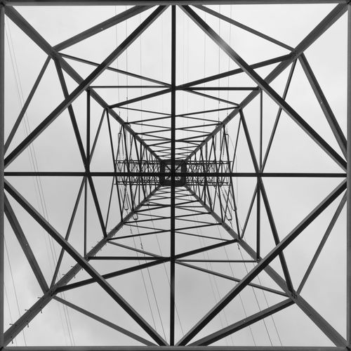 Geometry of Energy # 061871 Power Transmission Line The Architect - 2018 EyeEm Awards Abstract Architecture Built Structure Connection Electrical Power Geometry Low Angle View Technology