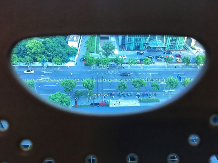 View of airplane seen through window