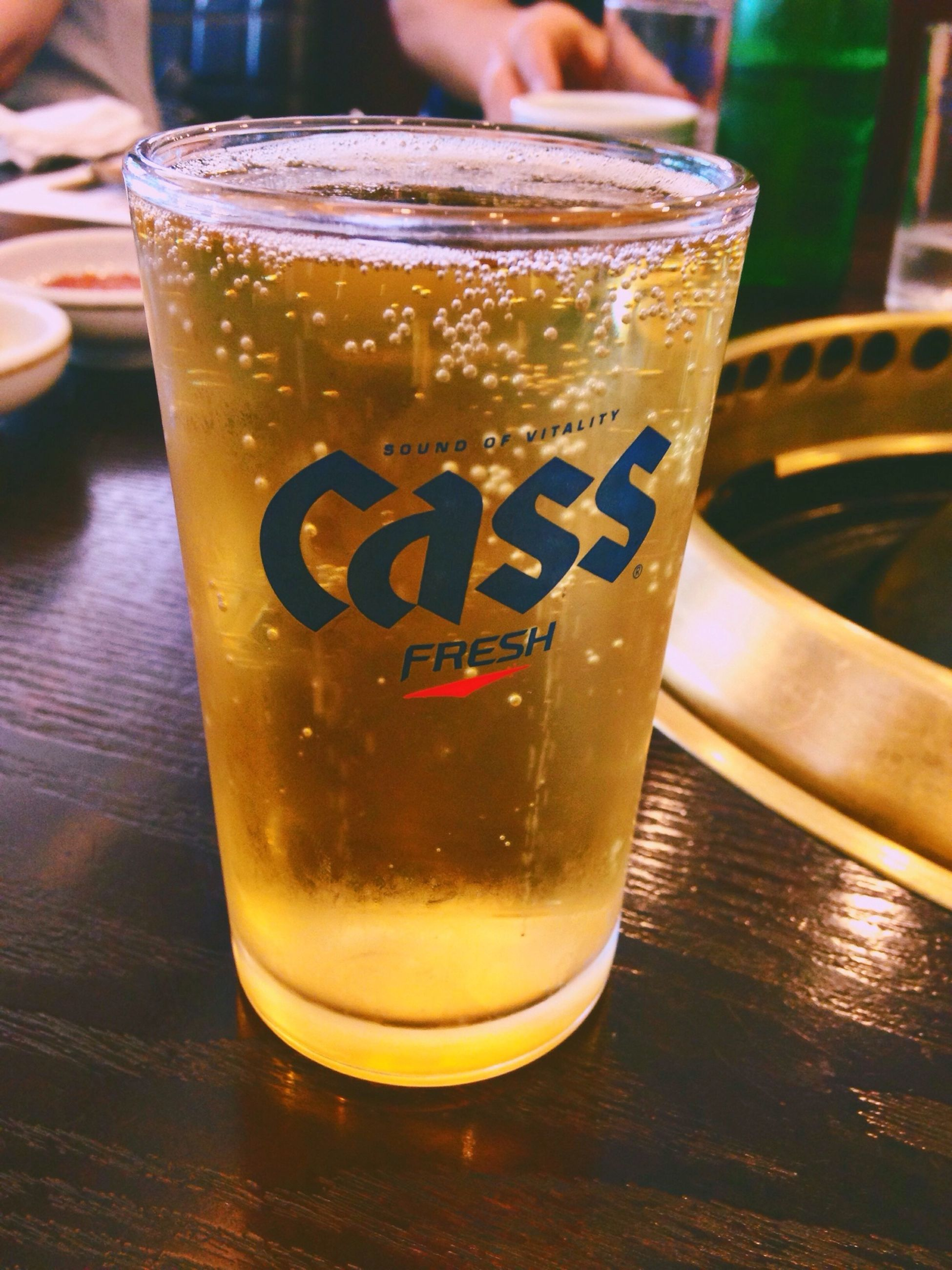 drink, food and drink, text, refreshment, western script, indoors, drinking glass, table, communication, close-up, freshness, still life, focus on foreground, alcohol, frothy drink, glass - material, beer - alcohol, beer glass, restaurant, coffee - drink