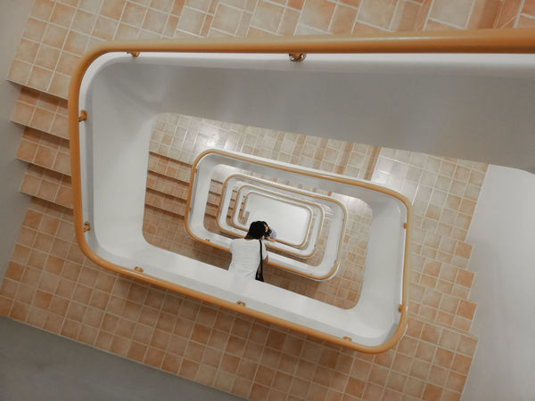 Upside-down or sideways.... Architecture Bathroom Built Structure Directly Above Domestic Bathroom Domestic Room Flooring High Angle View Home Human Representation Hygiene Indoors  One Person Pattern Public Building Public Restroom Railing Representation Staircase Tile Tiled Floor My Best Travel Photo
