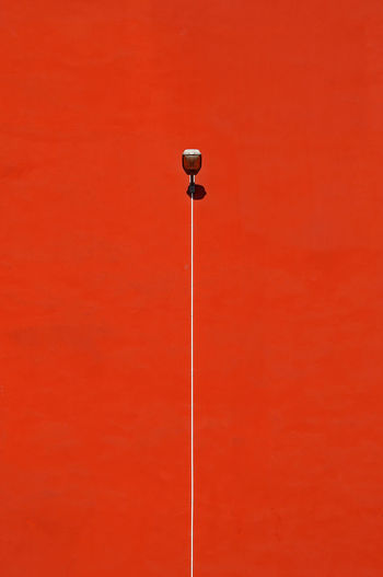 Street Light On Red Wall