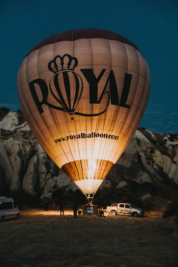 Transportation Hot Air Balloon Mode Of Transportation Air Vehicle Nature Sky Travel Balloon Car Incidental People Motor Vehicle Text Flying Mid-air Illuminated Land Vehicle Travel Destinations Outdoors Land Western Script Ballooning Festival