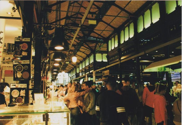 Mercado San Miguel, Madrid. Analogue Photography Mercado Paella Adult Architecture City Crowd Crowd Of People Fair Food Food Market Illuminated Indoors  Lifestyles Market Men Mercado San Miguel Night People Real People Retail  Standing Store Women