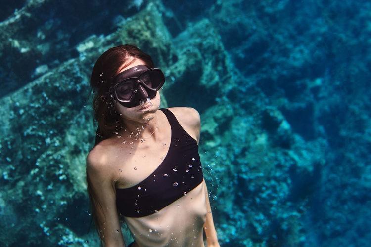 Woman wearing sunglasses in swimming pool
