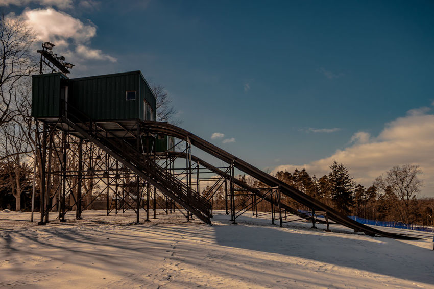 All Ready for the Kids Architecture Built Structure Cloud - Sky Composition Engineering Low Angle View Outdoors Perspective Sky Sledding Toboggan Toboggan In Winter Tobogganing