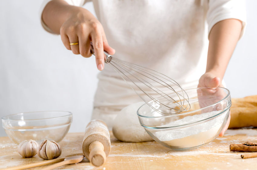 Apron Batter Bowl Domestic Kitchen Dough Egg Flour Food Food And Drink Homemade Indoors  Ingredient Kitchen Kitchen Counter Kneading Making Midsection Mixing Mixing Bowl One Person Preparation  Preparing Food Raw Food Rolling Pin Wire Whisk