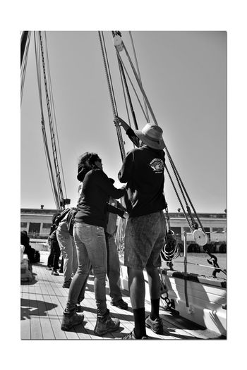 Hoisting The Sails 1 Aboard The Alma 1869 80 Ft. Scow Schooner Sailing San Francisco Bay Bnw_summer Memory's Bnw_friday_eyeemchallenge A Day On The Bay Ships Rigging Monochrome Lovers Monochrome Deck Hands For A Day Shadows Black & White Black & White Photography Black And White Black And White Collection  Waterfront♥ Warehouse Bayview Harbor Ropes Pulleys Nautical Vessel Wooden-hulled Flat-bottomed Sailing Ship