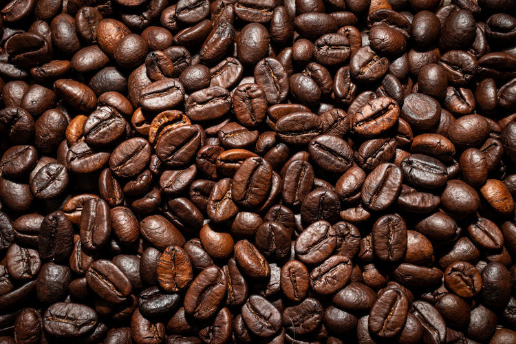 Roasted coffee beans used as for a background