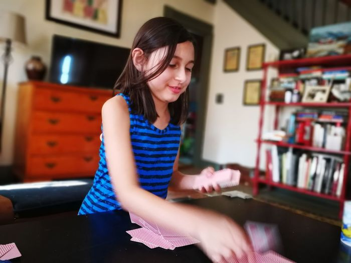 Girl playing cards at home