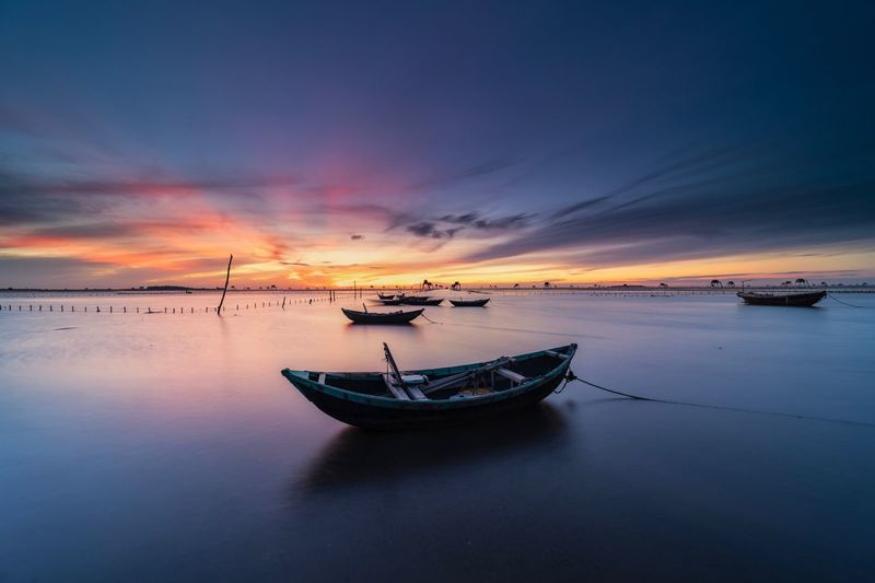 Nautical Vessel Water Transportation Sky Sunset Mode Of Transportation Sea Scenics - Nature Beauty In Nature Tranquility Cloud - Sky Tranquil Scene Horizon Nature No People Travel Outdoors Orange Color Moored Idyllic Transportation Beauty In Nature Tranquility Reflection Nature Waterfront