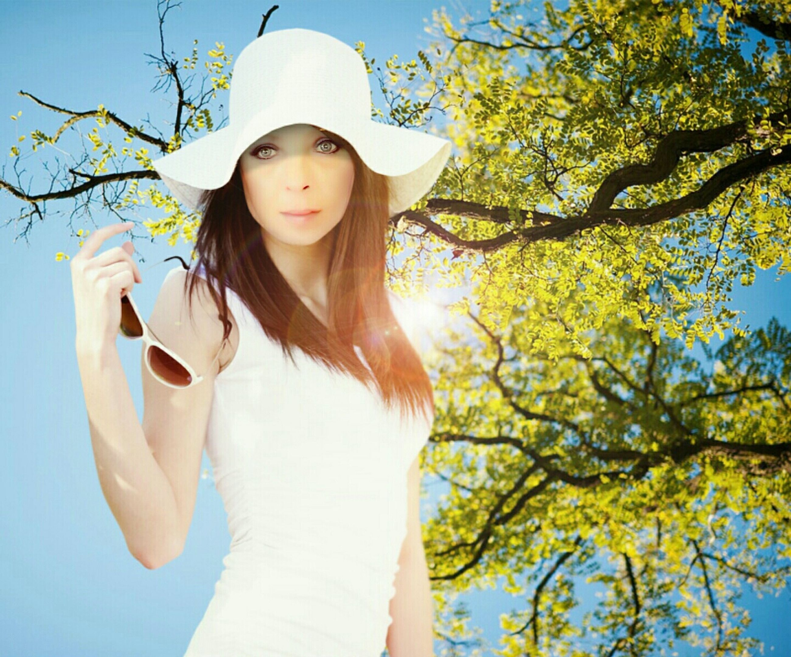 tree, young women, long hair, young adult, leisure activity, person, sunlight, waist up, front view, beauty, casual clothing, outdoors, nature, focus on foreground, sun