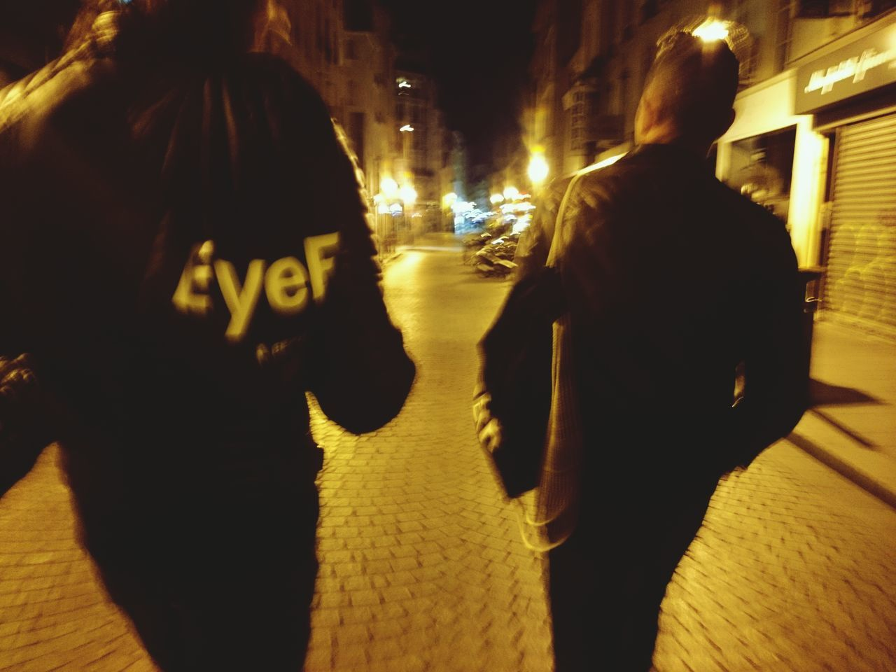 night, street, city, rear view, blurred motion, walking, real people, illuminated, building exterior, architecture, outdoors, men, people