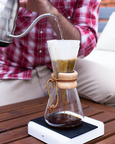 coffee making Chemex Close-up Coffee Coffee - Drink Day Drink Drinking Glass Focus On Foreground Food And Drink Freshness Human Body Part Human Hand Indoors  Leisure Activity Low Section Making Men Midsection One Person People Pouring Real People Refreshment Table Technology