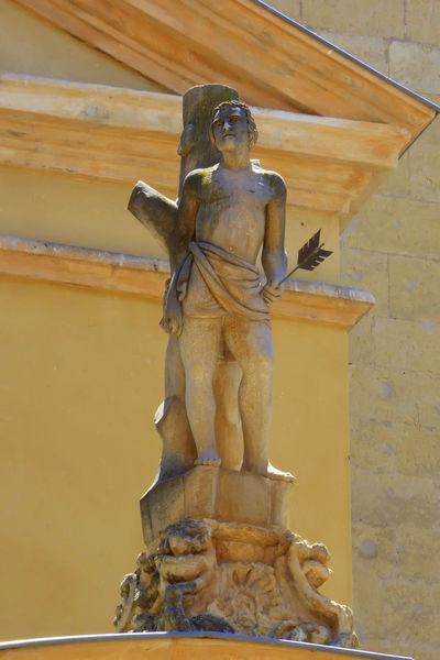 Architecture Art And Craft Built Structure Craft Creativity Day Human Representation Male Likeness Representation Saint Sebastian Sculpture Statue