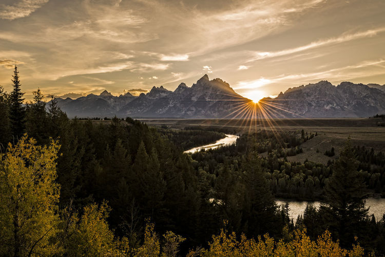 Sunset at Snake River Overlook during fall. This location was popularised by Ansel Adams. Grand Teton National Park  Nature Landscape Sunset Tree Mountain Scenics - Nature Beauty In Nature Sky Mountain Range Mountain Peak Idyllic Land National Park Yellowstone National Park Wyoming Landscape Wyoming Fall Beauty