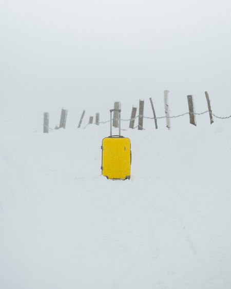 Yellow trolley standing in snow storm EyeEm Nature Lover Travel Travel Photography Traveling Home for the Holidays Trolley Beauty In Nature Close-up Cold Temperature Day Leisure Activity Luggage Luggage Trolleys Luggage, Travel  Nature No People Outdoors Snow Snowy Travel Destinations Travelgram Weather White Background Winter Yellow
