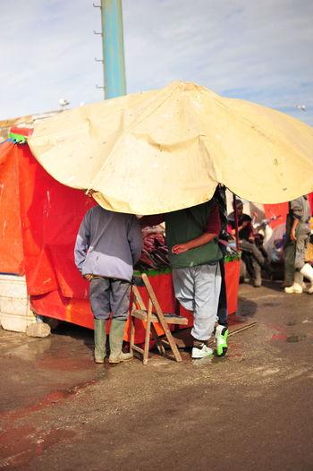 People on umbrella during rainy season