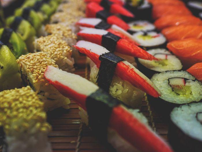 Close-up of sushi on tray