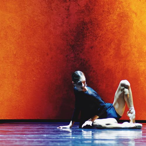 """A scene from """"Schubert"""", my new ballet at Staatsoper Hannover featuring Keren Leiman. Wall - Building Feature Sitting Person Young Adult Contemplation Ballett Ballet Dancer Ballerina Schubert Ballet ❤ Textured  Vibrant Color Weathered Hannover Ballet Orange Color Hannover Legs"""