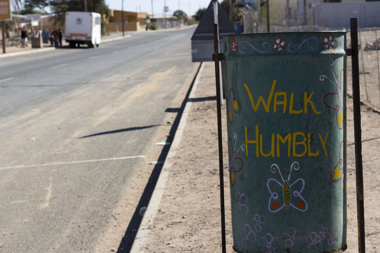 Architecture Communication Cute Sign Day Namibia City Namibia Landscape No People Outdoors Sign Road Somewhere In Namibia Text Walk Humbly