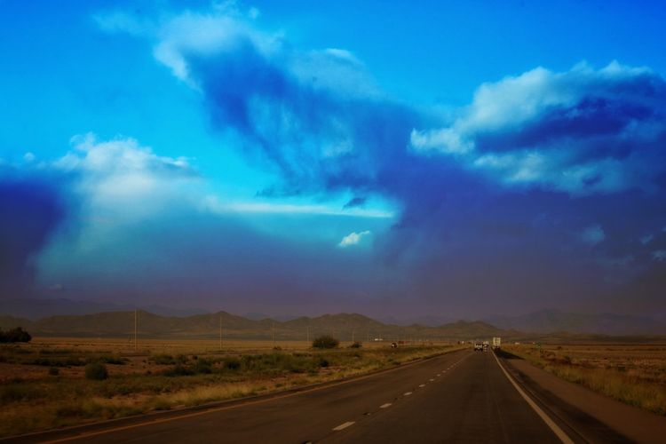 Sky Cloud - Sky Road Transportation Landscape Direction Environment Beauty In Nature Scenics - Nature Nature The Way Forward No People Mountain Road Marking Tranquil Scene Diminishing Perspective Tranquility Marking Land Symbol