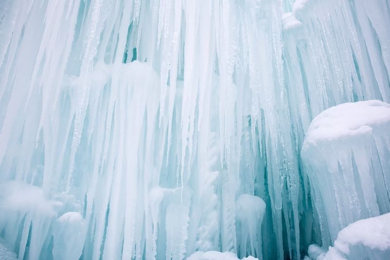 Low Angle View Of Frozen Waterfall