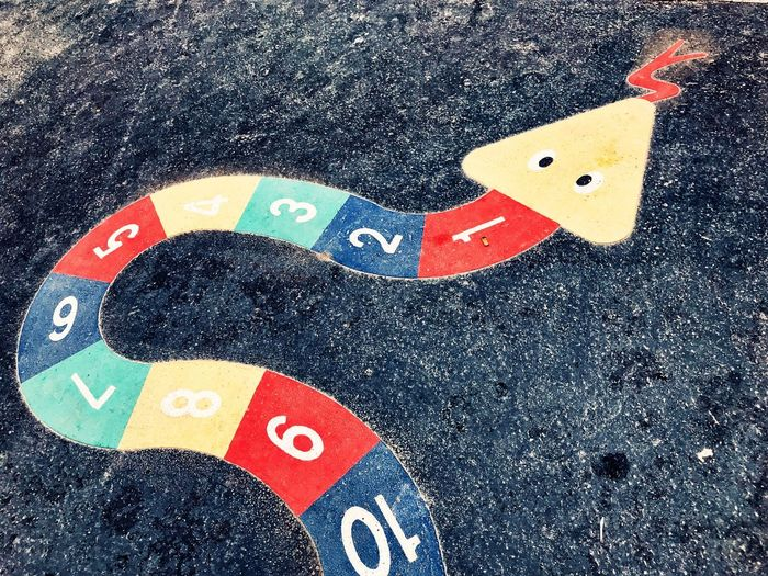 Snake game 🇫🇷 Game No People High Angle View City Close-up Street Day Art And Craft Representation Road Multi Colored Animal Representation Creativity Outdoors Pattern Red Symbol Number Shape