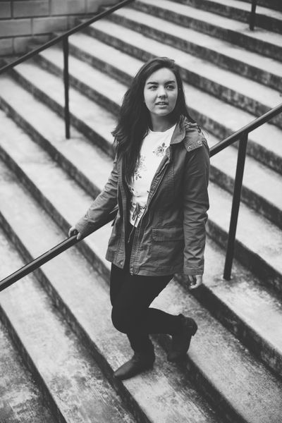 Beautiful Woman Black And White Casual Clothing Day Front View Full Length Jacket Leisure Activity Lifestyles Looking At Camera One Person Outdoors People Portrait Railing Real People Staircase Standing Steps Steps And Staircases Walking Young Adult Young Women