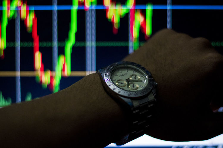 See stock chart time See Stock Chart Time Human Body Part Human Hand Watch Time Hand Wristwatch Real People One Person Body Part Indoors  Close-up Unrecognizable Person Human Finger Men Number Finger Lifestyles Personal Perspective Multi Colored Personal Accessory Luxury