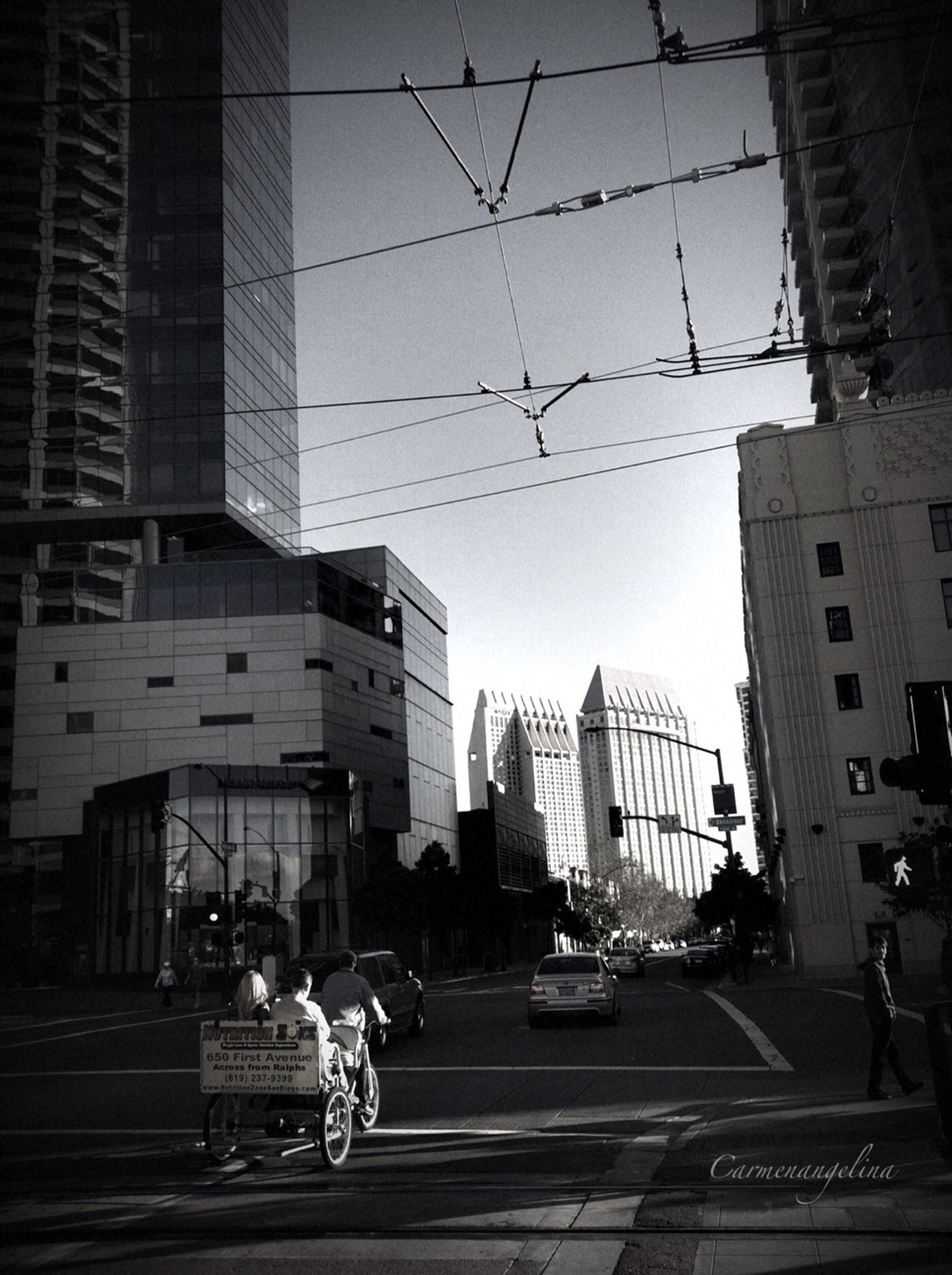 building exterior, architecture, built structure, city, transportation, street, city life, car, land vehicle, mode of transport, city street, road, incidental people, building, sky, zebra crossing, travel, office building, on the move