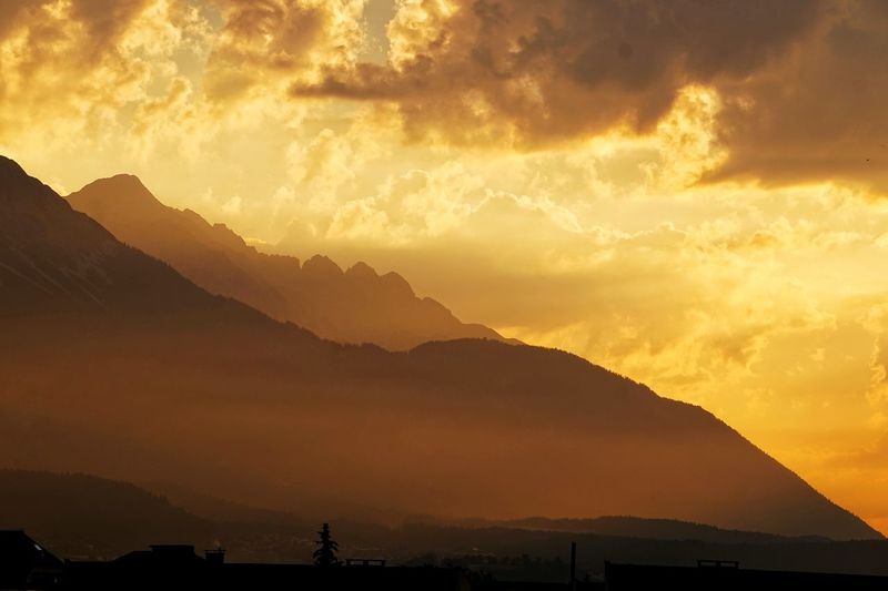 Sunrise in Innsbruck Clouds Alps Mountains Sunrise Golden Astronomy Mountain Sunset Beauty Photography Themes Gold Colored Gold Silhouette Orange Color Dramatic Sky Sun My Best Photo