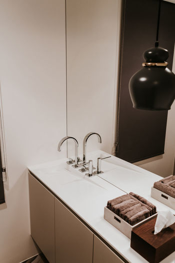 Sink Indoors  Home Domestic Room Faucet No People Bathroom Home Interior Domestic Bathroom Home Showcase Interior Wealth Absence Modern Luxury Household Equipment Mirror Hygiene Tile Illuminated Towel