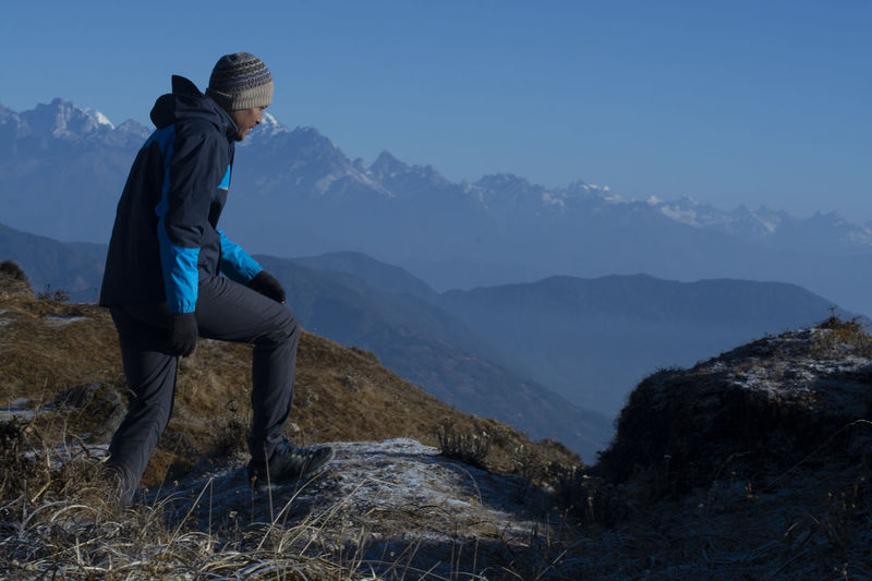Mount Kanchenjunga Mountain One Person Beauty In Nature Scenics - Nature Leisure Activity Real People Mountain Range Hiking Tranquil Scene Lifestyles Tranquility Full Length Non-urban Scene Nature Sky Rock Landscape Environment Rock - Object Outdoors