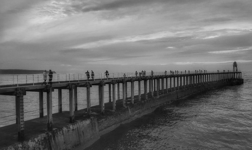 Whitby pier on a cold damp day Tranquility Pier Coastline Bridge - Man Made Structure Outdoors Black And White Photography Close-up Black And White Building Exterior Architectural Feature Portrait Landscape Malephotographerofthemonth Landscape_photography Fujifilm Travel Destinations Whitby Pier Whitby View Whitbypier Architectural Detail Brigdeovertroutwater Bnw_captures Bnw Photography