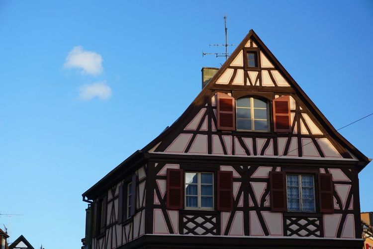Historical craftmanship in the beautiful city of Colmar (Alsace, France). Alsace Elsass French House Historical Historic Building Fachwerk Half-timbered Beautiful Day Autumn colors Colmar Architecture House Decoration Blue Sky Rosé Pink House Rosy House Pink Fassade French Architecture Traditionelles Handwerl Handwerk Architecture Sky Built Structure House Blue Building Exterior Day Outdoors Travel Destinations Colour Your Horizn