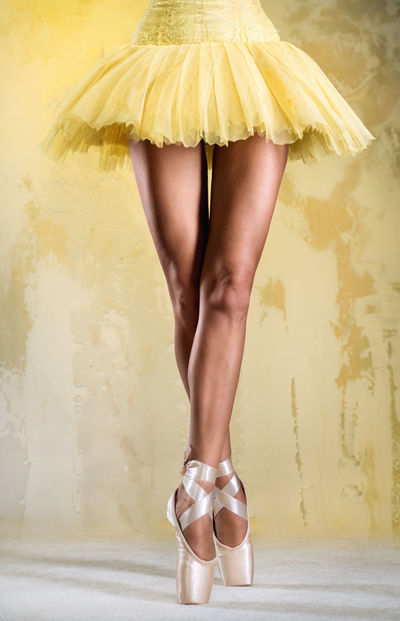 Ballerina on point over obsolete wall Artist Ballerina Ballet Ballet Dancer Ballet Tutu Beautiful Woman Caucasian Choreography Dancer Female Flexibility Girl Human Body Part Human Leg Indoors  On Pointe People Pose Professional Dancer Slender Slim Standing Studio Shot Toe Woman
