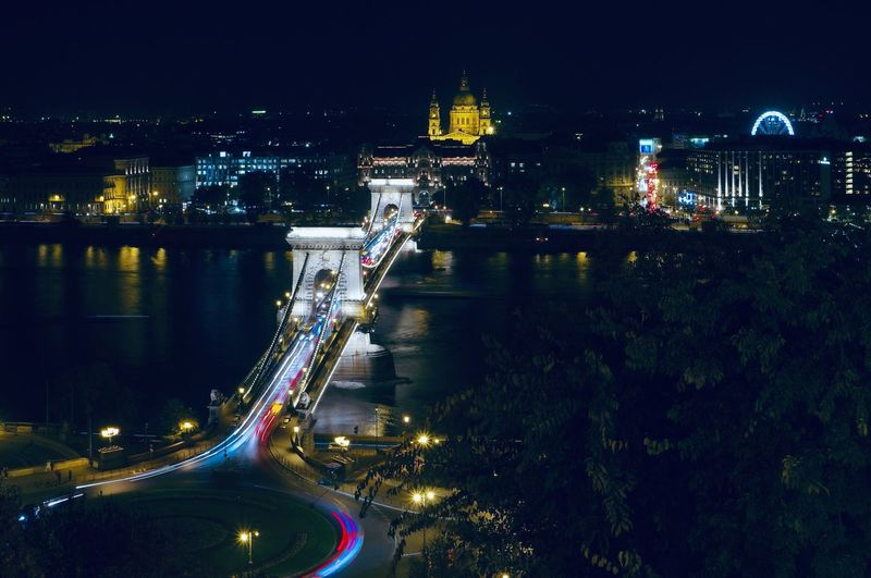 High angle view of illuminated bridge over river at night