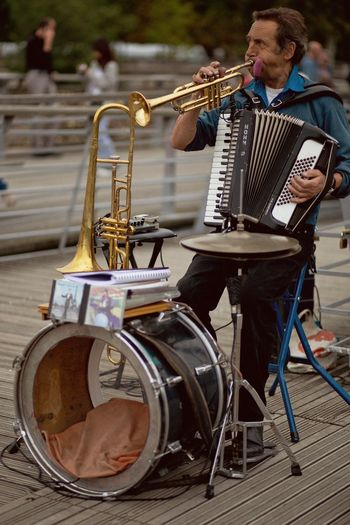You r Awesome! Accordion Aerophone City Life Drum Lifestyle Musician Old But Awesome Street Entertainment Streetartist Streetphotography Trumpet Onemanband Up Close Street Photography