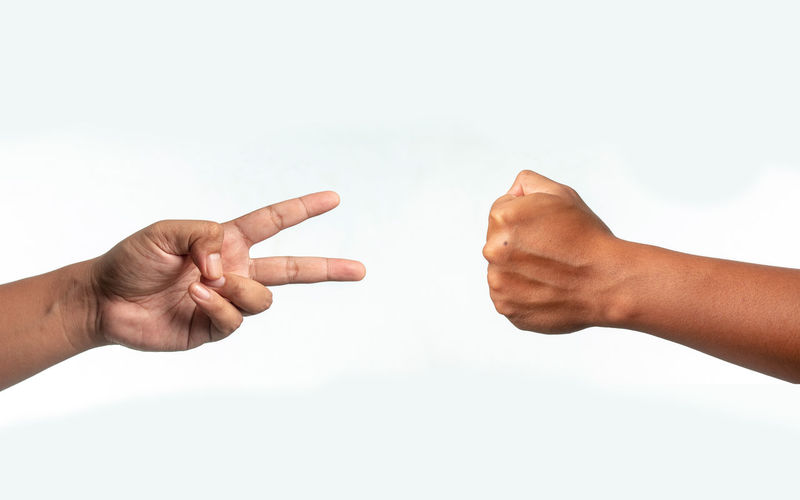 Cropped image of people hand against white background