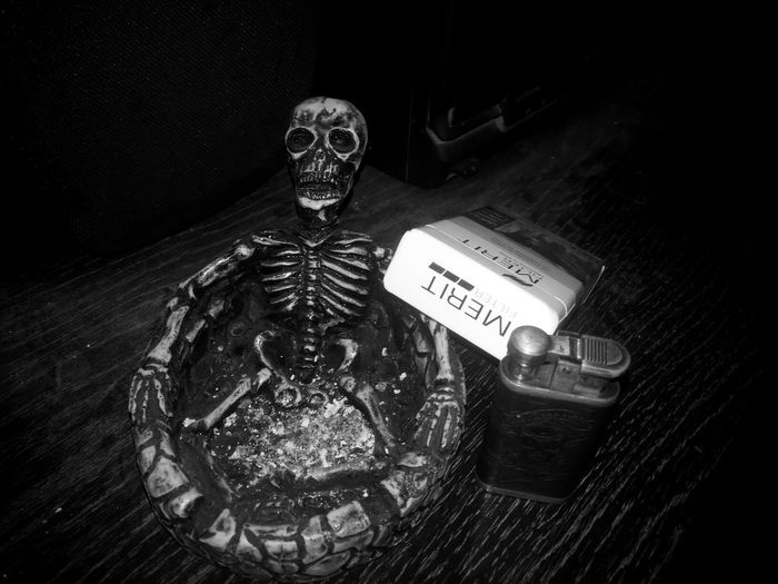 No People Indoors  The Week On EyeEm Black Background Front View Photographer Smoking Night Cigarrettes Takin By Me Ashtray  Skull Bones Weed Skeleton Hash Vibe Lighter🔥💨 Fire Backfire B&W Portrait B&w Illuminated Visible Darkness