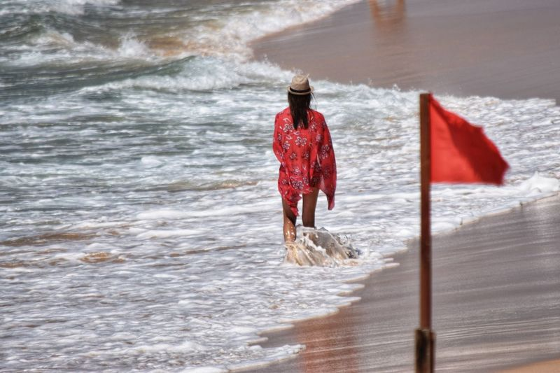 Water Red Nature Real People One Person Wave Rear View Sea Full Length Walking Clothing Beach Flowing Water Outdoors Sunlight