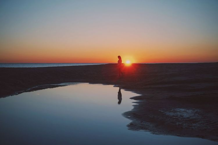 Sunset Beach Sun Nature Dark Calm Ocean Light Light And Shadow darkness and light Meditation Colors Sky Shine Woman Figure
