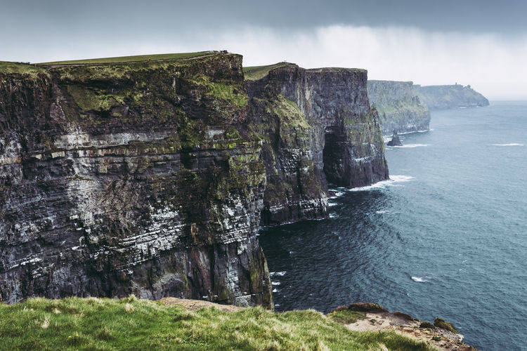 Beauty In Nature Water Sea Scenics - Nature Sky Rock Land Tranquil Scene Nature No People Tranquility Rock - Object Cliff Solid Day Rock Formation Non-urban Scene Beach Outdoors Rocky Coastline Coastline Eroded Stack Rock Formation Cliffs Of Moher